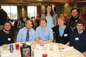 Members of the Southwestern Illinois College STEM Scholars program won the first-ever Richard Bowser Engineering Competition awarded at the recent Arch Builders Reunion banquet in St. Louis. Pictured, from left, seated, are SWIC students Chandler Scott of Scott Air Force Base, Josh Westenberger of Baldwin, Caleb Gray of Maryville, Joe McKinnon and Tyler Cronin, both of Troy; standing are, Jayda Pearman of Sparta and Kevin Brutto of Collinsville. Not pictured, student Ana Flores-Garcia of Collinsville and SWIC Associate Professor of Mathematics Jennifer Simonton, the faculty coordinator of the project, also particiapted. The competition, named for Arch tram designer Richard Bowser, challenged teams of college engineering students to modernize the way power is supplied to the Arch tram capsules to make it safer for the mechanics to perform maintenance on the system. SWIC STEM Scholars won with their proposal to convert the system to battery power. The teams were previously given a behind-the-scenes tour of the Gateway Arch tram system. SWIC competed against teams from Washington University and Southern Illinois University Edwardsville. The SWIC STEM Scholars program provides a select group of students a full-ride scholarship to study science, technology, engineering and math disciplines. In addition, these students are paired with faculty mentors, participate in study groups, take part in off-campus activities, such as college visits, and enroll in special topics courses. SWIC received a more than $600,000 National Science Foundation S-STEM grant to develop the STEM Scholars Program.