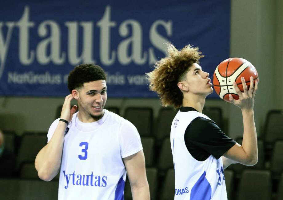 US basketball players LiAngelo Ball (L) and Lamelo Ball takes part in their first training session in Prienai, Lithuania, where they will play for the Vytautas club on January 5, 2018. Basketball-crazed Lithuania welcomed LiAngelo and LaMelo Ball, the two youngest sons of flamboyant Los Angeles entrepreneur LaVar Ball who recently made headlines due to a feud with US President Donald Trump. / AFP PHOTO / Petras MalukasPETRAS MALUKAS/AFP/Getty Images Photo: PETRAS MALUKAS, AFP/Getty Images / AFP or licensors