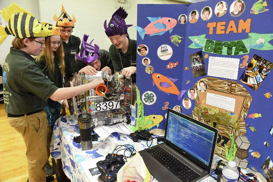 Members of the Seton Catholic High School team from Plattsburgh work on their robot during the 5th Annual Hudson Valley Albany FIRST (For Inspiration and Recognition of Science and Technology) Tech Challenge Qualifying Tournament at Albany Academy for Girls on Saturday, Jan. 13, 2018 in Albany, N.Y. (Lori Van Buren/Times Union) Photo: Lori Van Buren / 20042631A