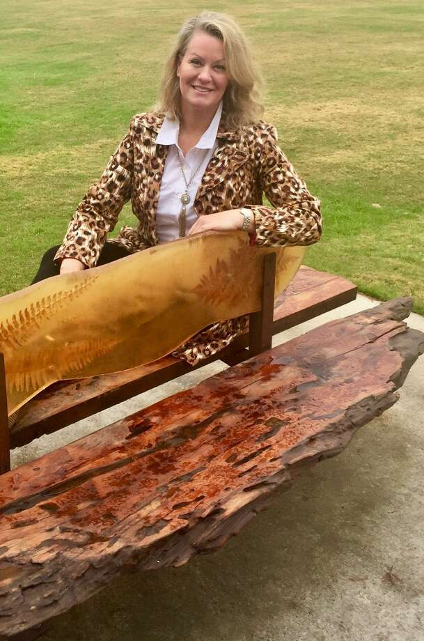 "Woodlands resident Cynthia Powell takes a moment to enjoy the public and functional art bench ""Amber"" by Luis Pavon (Malaga, Spain) in Town Green Park. Photo: Courtesy Photo"