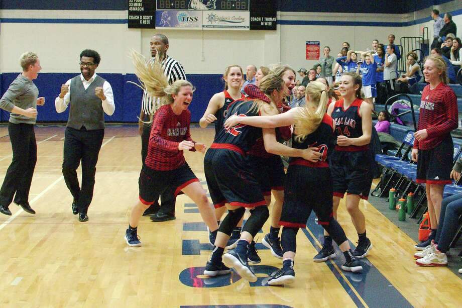 Clear Lake celebrates after Lady Falcon Tara Kessner (42) ties the score at the buzzer to put the game into overtime against Friendswood Friday in a District 24-6A basketball game. Clear Lake would win in the extra session. Photo: Kirk Sides / © 2018 Kirk Sides / Houston Chronicle