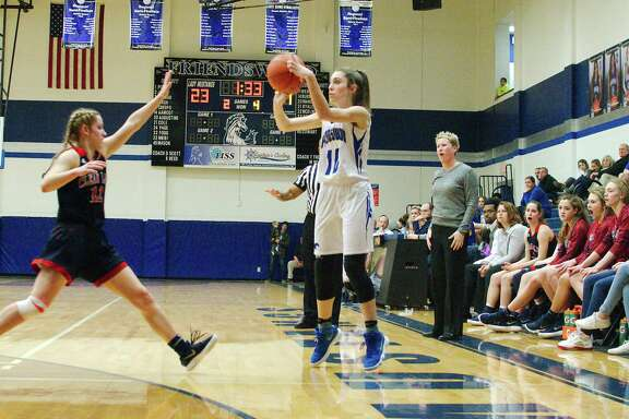 Friendswood's Nicole Nash (10) puts up a shot over Clear Lake's Caroline Decker (12)  at Friendswood High School.