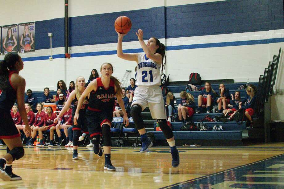 Friendswood's Kinsey Cole (21) drives to the basket past Clear Lake's Tara Kessner (42) Friday at Friendswood High School. Photo: Kirk Sides / © 2018 Kirk Sides / Houston Chronicle