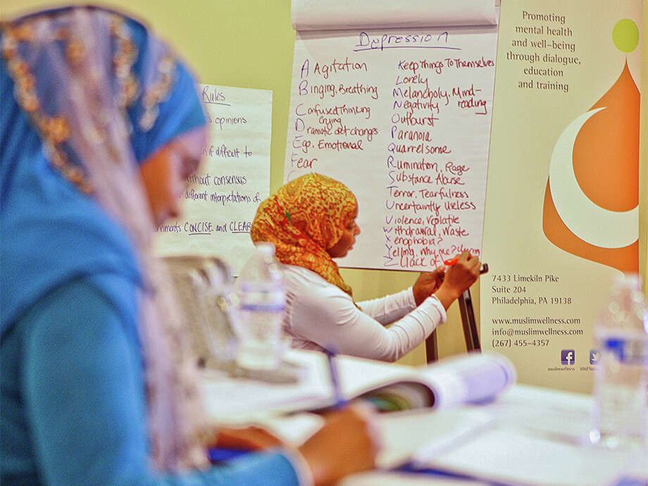 Women participate in a mental health training program for community members in Atlanta. Photo: Photo By Rahmeek Rasul