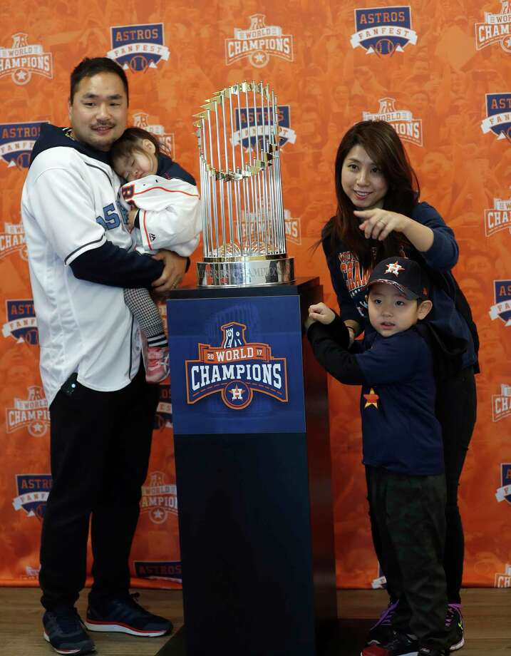 The Nakamura family gets their photo taken with the Astros Championship trophy during the Astros Fan Fest at. inute Maid Park,  Saturday, Jan. 13, 2018, in Houston. Photo: Karen Warren, Houston Chronicle / © 2018 Houston Chronicle