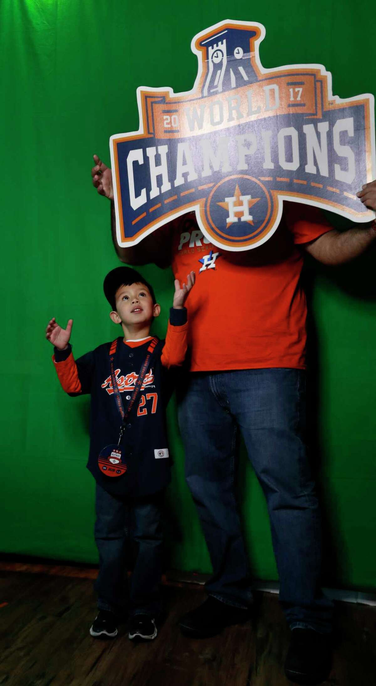 Eduardo Cardenas, 5, gets his photo taken with his dad, Luis, in the social media photo booth during the Astros Fan Fest at. inute Maid Park, Saturday, Jan. 13, 2018, in Houston.