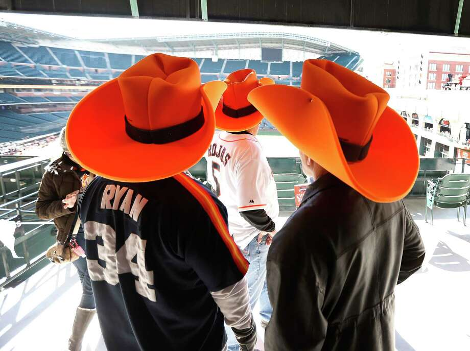 Fans take in the ballpark wearing large orange cowboy hats during the Astros Fan Fest at Minute Maid Park,  Saturday, Jan. 13, 2018, in Houston. Photo: Karen Warren, Houston Chronicle / © 2018 Houston Chronicle