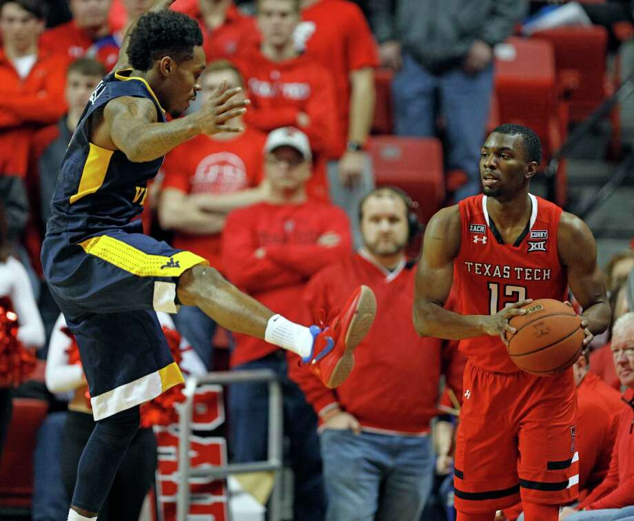 West Virginia's Daxter Miles (4) tries to block Texas Tech's Keenan Evans (12) as he passes the ball in bounds during the first half of an NCAA college basketball game, Saturday, Jan. 13, 2018, in Lubbock, Texas. Photo: Brad Tollefson, AP / FR171432 AP