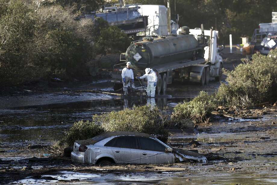 Crews pump mud off of Highway 101 in Montecito (Santa Barbara County). The California Department of Transportation does not yet know when the key highway will reopen. Photo: Marcio Jose Sanchez, Associated Press