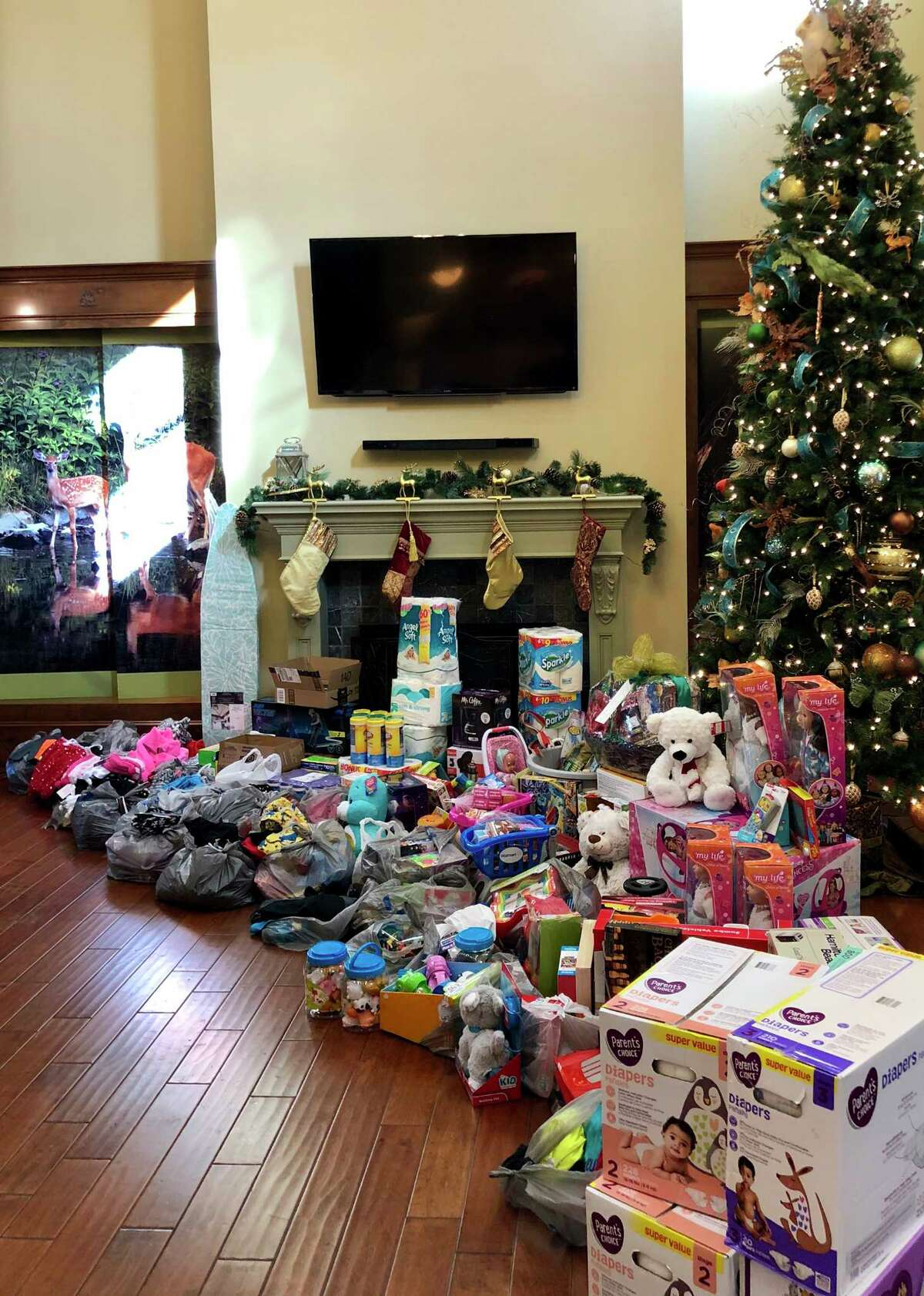 After being approached by local teens, the Woodforest community went all out collecting clothes, household supplies, diapers and much more for the Montgomery County WomenÂ?'s Center.