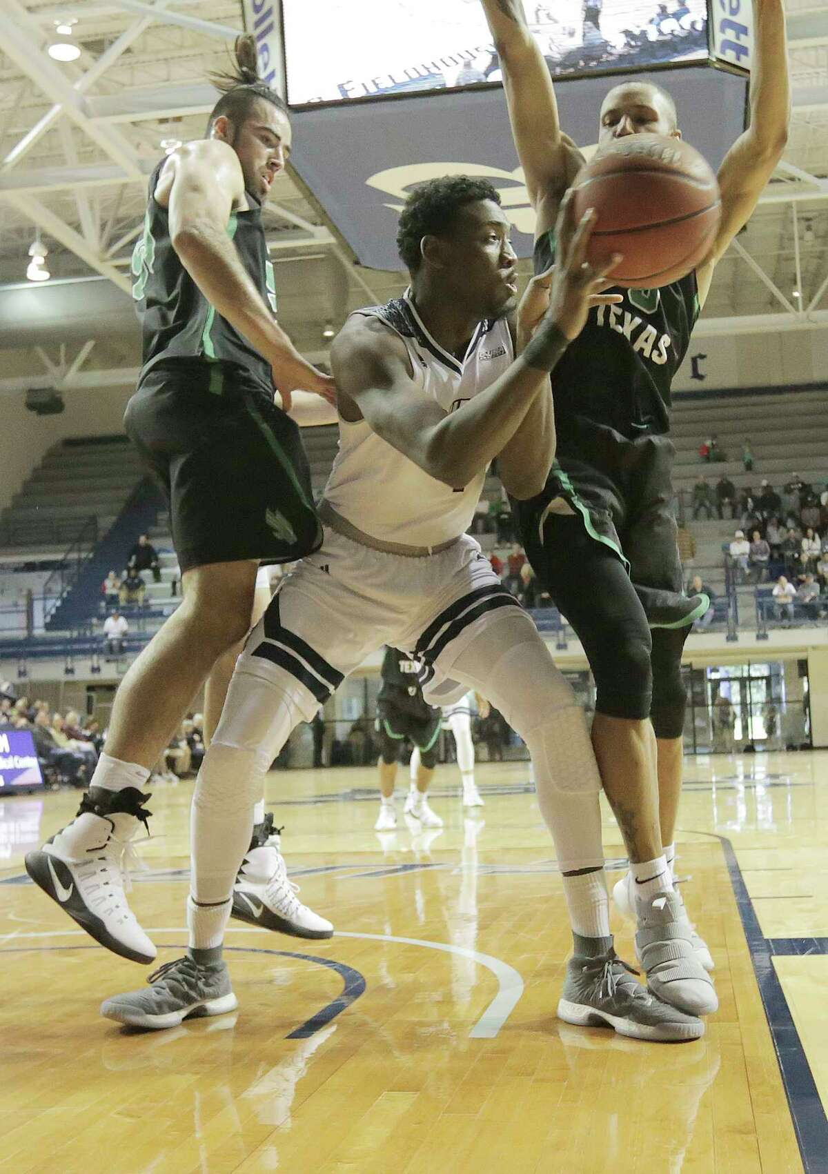 Rice Owls forward Dylan Jones (4) dishes off the ball under the basket during an NCAA game against North Texas at Tudor Fieldhouse on Saturday, Jan. 13, 2018, in Houston.