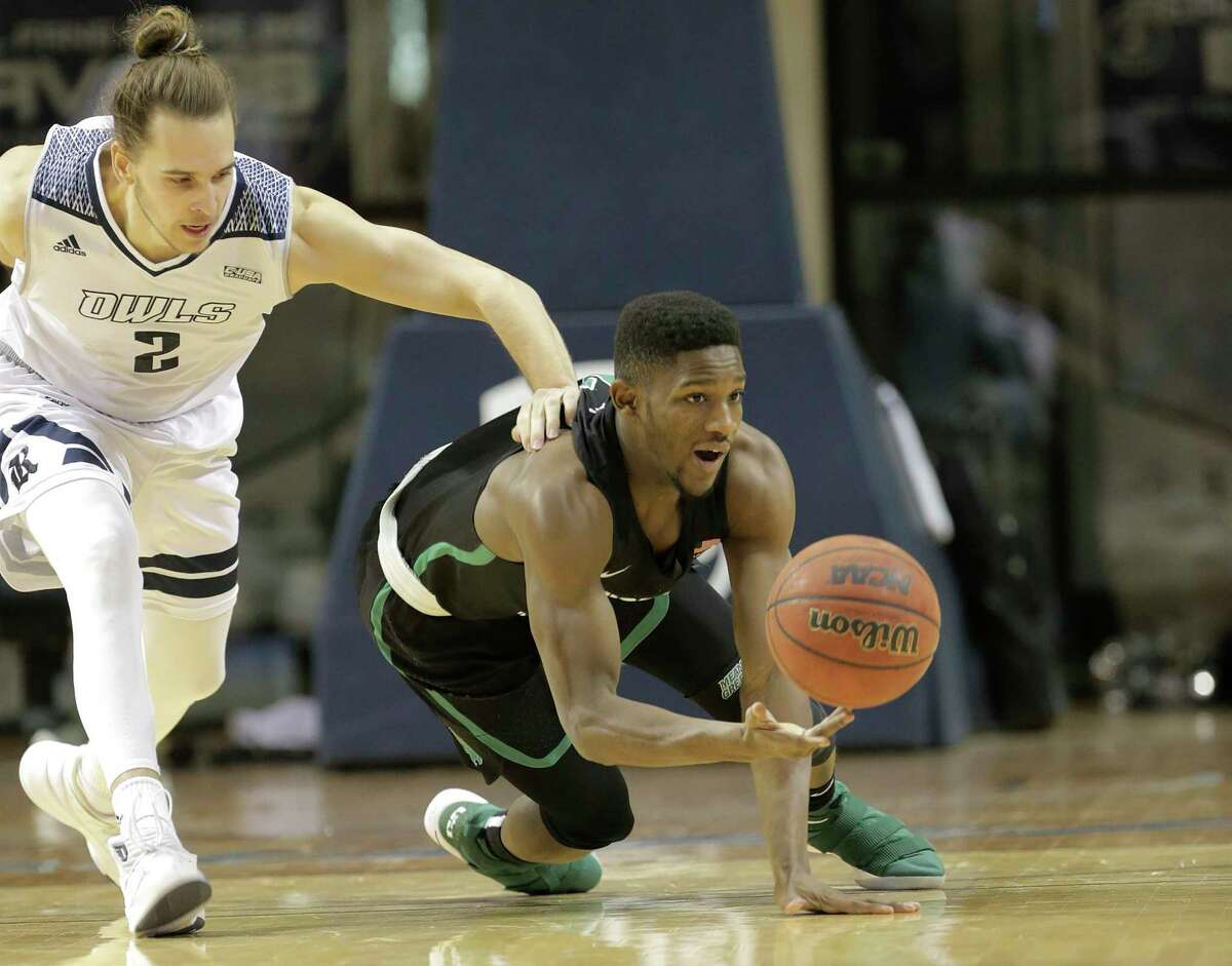 North Texas Mean Green guard Michael Miller (23) tries to regain control of the ball against Rice Owls guard A.J. Lapray (2) in the first half at Tudor Fieldhouse on Saturday, Jan. 13, 2018, in Houston.