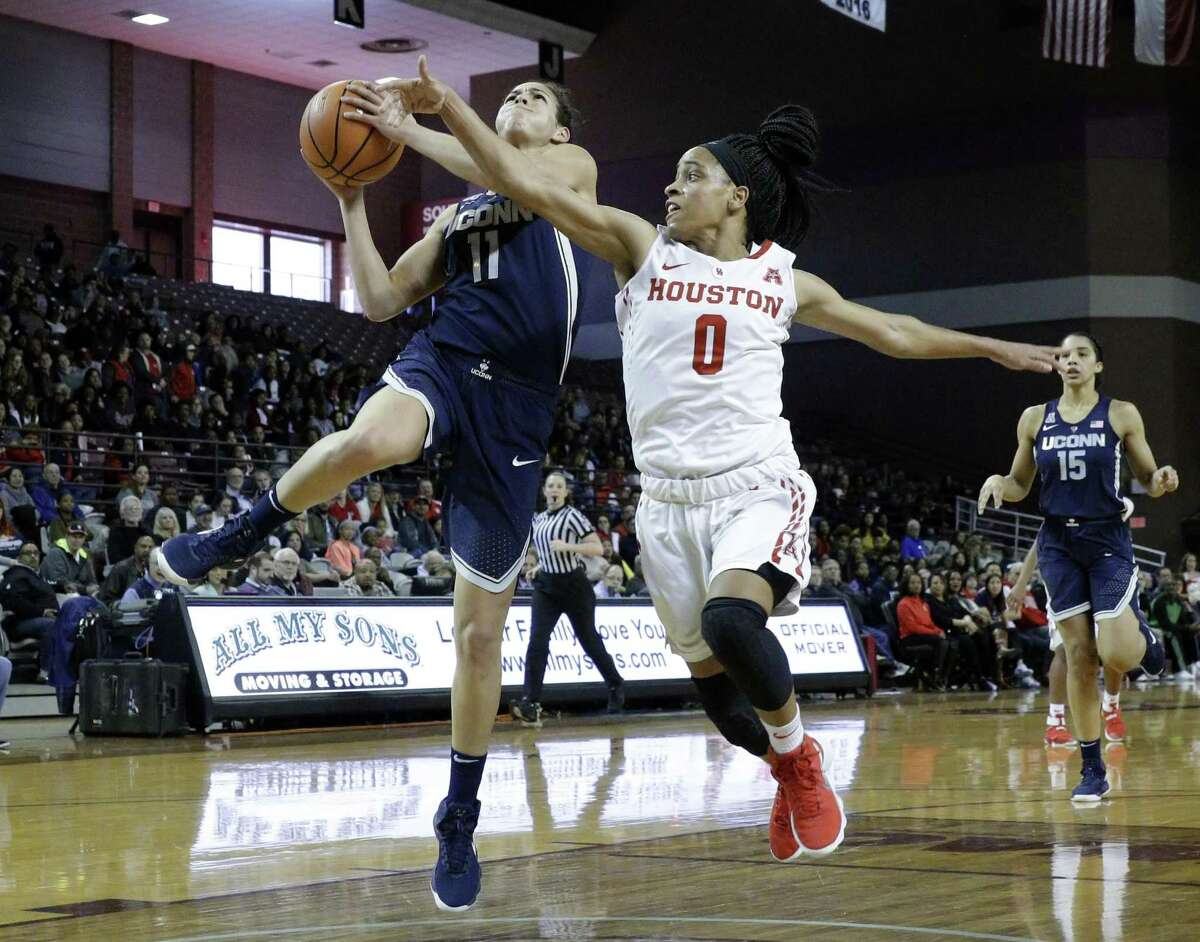 UConn's Kia Nurse, left, puts up a shot in front of Houston's Angela Harris on Saturday.