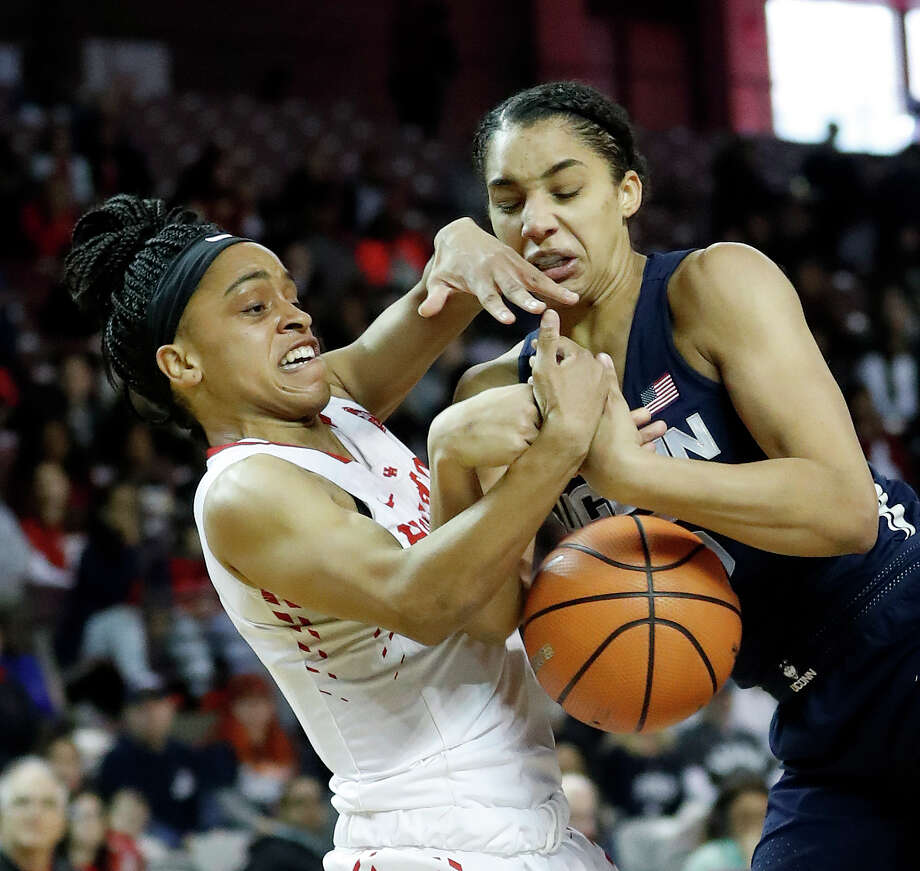 Houston Cougars guard Angela Harris (0) battles for control of the ball against Connecticut Huskies forward Gabby Williams (15) during the first half of a NCAA basketball game at Texas Southern University Saturday, Jan. 13, 2018, in Houston. Photo: Karen Warren, Houston Chronicle / © 2018 Houston Chronicle