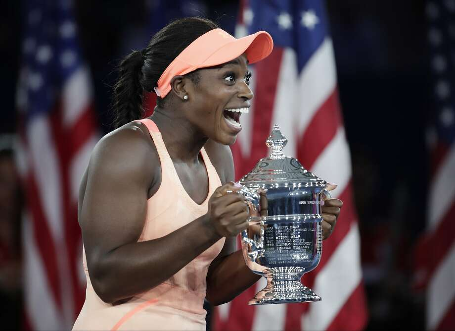 Sloane Stephens, of the United States, holds up the championship trophy after beating Madison Keys, of the United States, in the women's singles final of the U.S. Open tennis tournament, Saturday, Sept. 9, 2017, in New York. (AP Photo/Julio Cortez) Photo: Julio Cortez, Associated Press