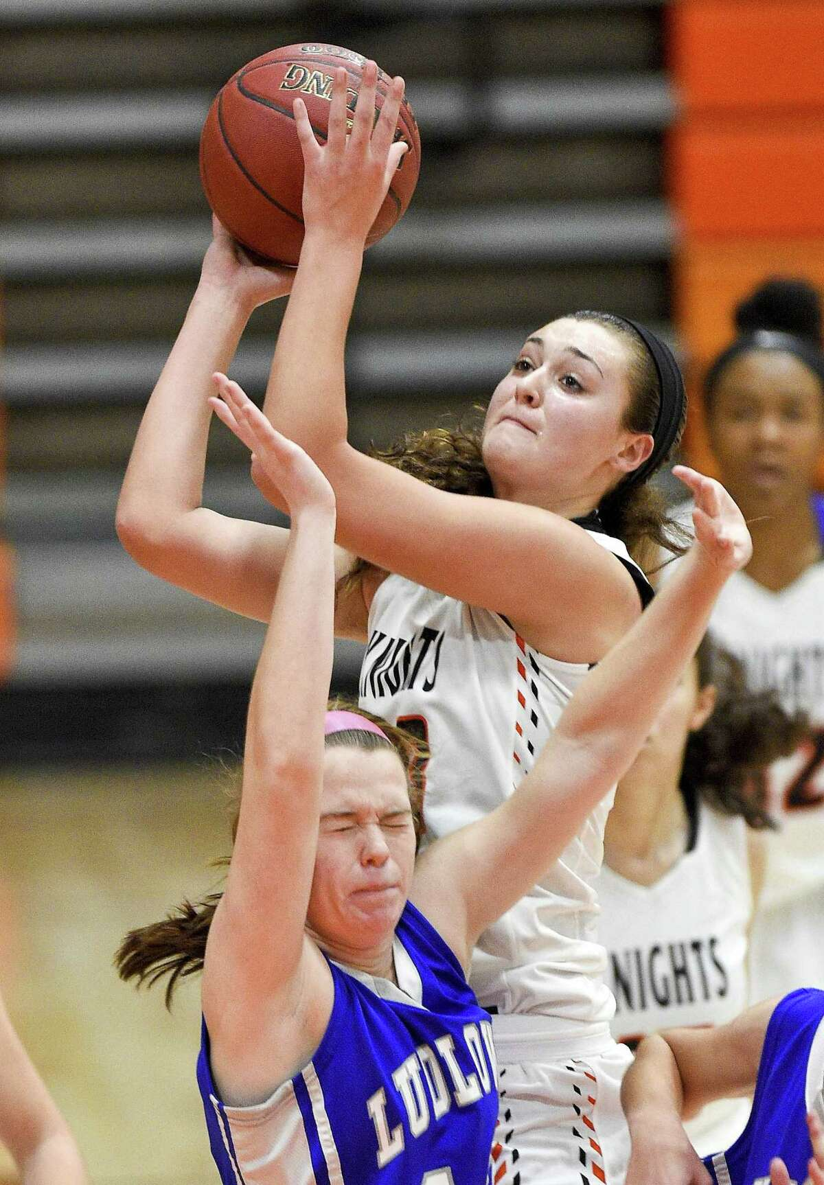 Stamford's Alexa Kellner (23) puts up a shot against Fairfield Ludlowe's Anna Catherine Paulmann (10) during a girls varsity basketball game at Stamford High School in Stamford, Conn. on Friday, Dec. 22, 2017. Stamford defeated Fairfield Ludlowe 38-33.