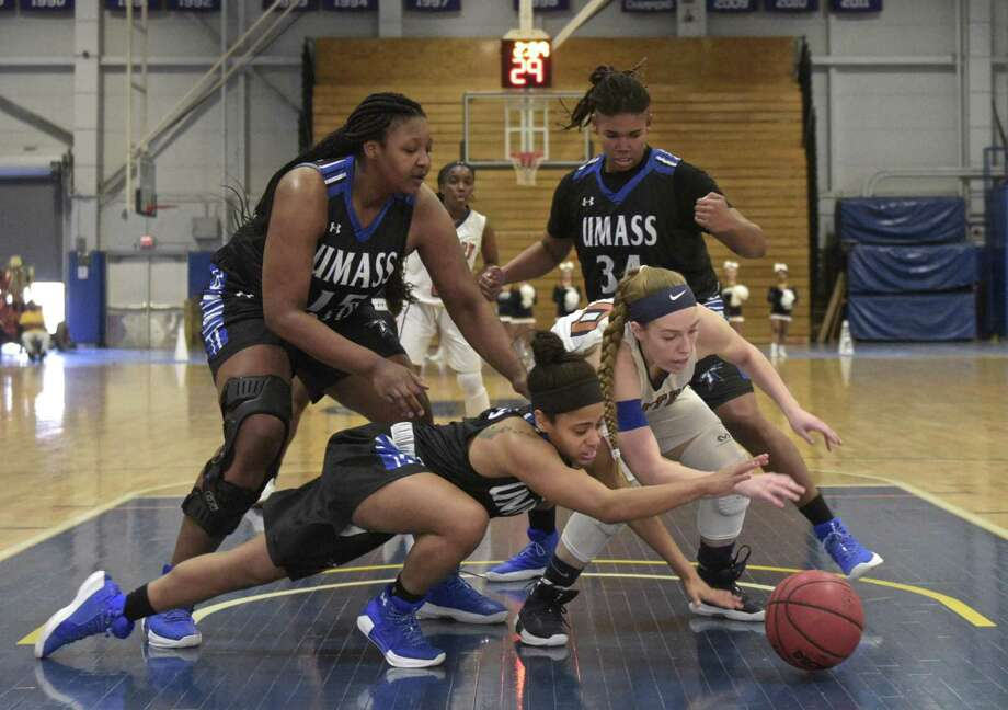 UMass Boston's Lydia Vital (3) and Western's Jancy Sherwood (30) dive for the ball under Western's basket in the women's basketball game between UMass Boston and Western Connecticut State University on Saturday afternoon, January 13, 2018, at the O'Neill Center on the WCSU Westside campus, in Danbury, Conn.Behind them are Boston's Shania Osborne (15) , of Fairfield, Conn, and Raven Kelsey (34). Photo: H John Voorhees III / Hearst Connecticut Media / The News-Times