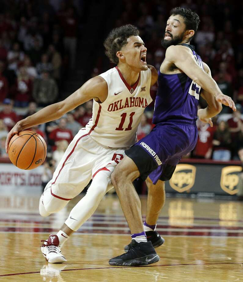 Oklahoma's Trae Young (11) drives the ball against TCU's Alex Robinson (25) during the second half of an NCAA college basketball game in Norman, Okla., Saturday, Jan. 13, 2018. (AP Photo/Garett Fisbeck) Photo: Garett Fisbeck, Associated Press