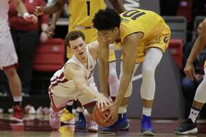 California forward Justice Sueing, right,  and Washington State guard Malachi Flynn, left, go after the ball during the first half of an NCAA college basketball game in Pullman, Wash., Saturday, Jan. 13, 2018. (AP Photo/Young Kwak)