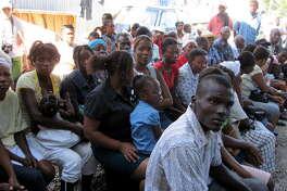 Homeless earthquake victims in Kafou Fey, Haiti await a health checkup from a Capital Region group led by Dr. Bob Paeglow of Albany. (Paul Grondahl / Times Union)