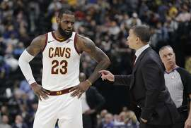 Cleveland Cavaliers head coach Tyronn Lue talks with LeBron James during the second half of an NBA basketball game against the Indiana Pacers, Friday, Jan. 12, 2018, in Indianapolis. Indiana won 97-95. (AP Photo/Darron Cummings)