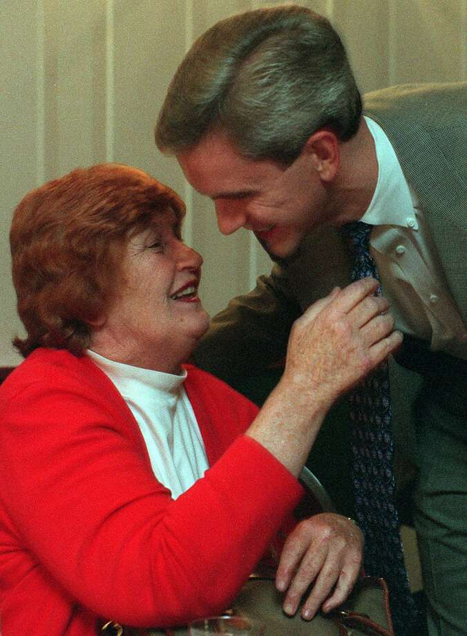 Anne McDonald is congratulated by her son, Andrew McDonald, after winning re-election in 1998. Photo: Staff File Photo