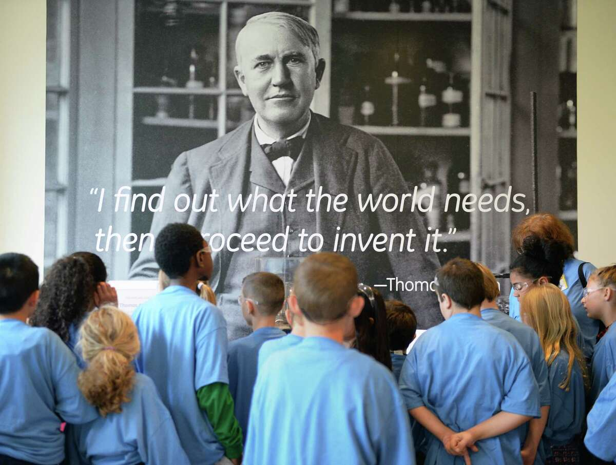 Area 4th grade students look at a portrait of Thomas Edison at GE Global Research during their annual Science Day Thursday Nov. 2, 2017 in Niskayuna, NY. (John Carl D'Annibale / Times Union)