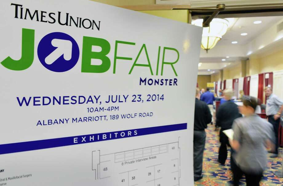 Job hunters fill into the Times Union Job Fair at the Albany Marriott Wednesday July 23, 2014, in Colonie, NY.  (John Carl D'Annibale / Times Union) Photo: John Carl D'Annibale / 00027884A