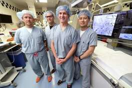From left, Drs. Joseph Curtis, Joseph Akar, James Freeman and Ben Lin are photographed in the Cardiac Electrophysiology Laboratory at Yale New Haven Hospital.