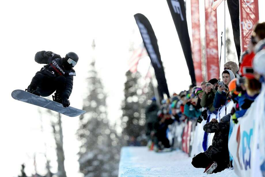 Shaun White (left) competes in his final run during the men's scowboard halfpipe final during the U.S. Grand Prix in Snowmass, Colo., on Saturday. Photo: Matthew Stockman, Getty Images