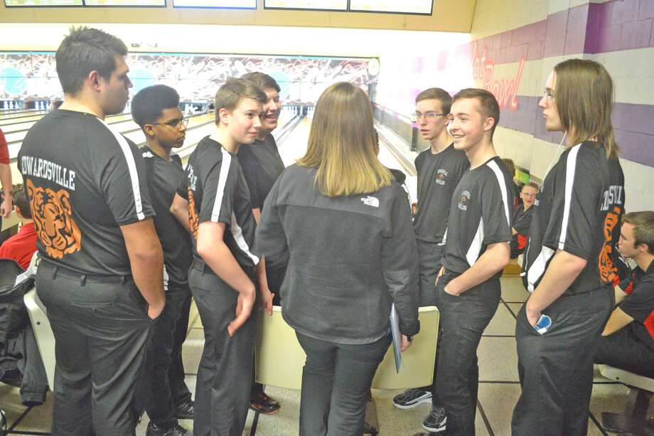 Members of the Edwardsville boys' bowling team listen to coach Kimber Wilderman between the fifth and sixth games at the Triad Regional, held Saturday at Camelot Bowl in Collinsville.