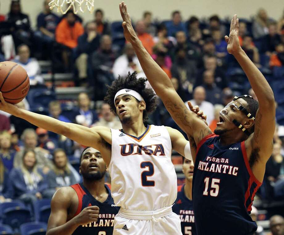 The Runner's Jhivvan Jackson stretches away from Jailyn Ingram to lay in a shot as UTSA hosts Florida Atlantic at the Convocation Center on January 13, 2018 Photo: Tom Reel, Staff / San Antonio Express-News / 2017 SAN ANTONIO EXPRESS-NEWS