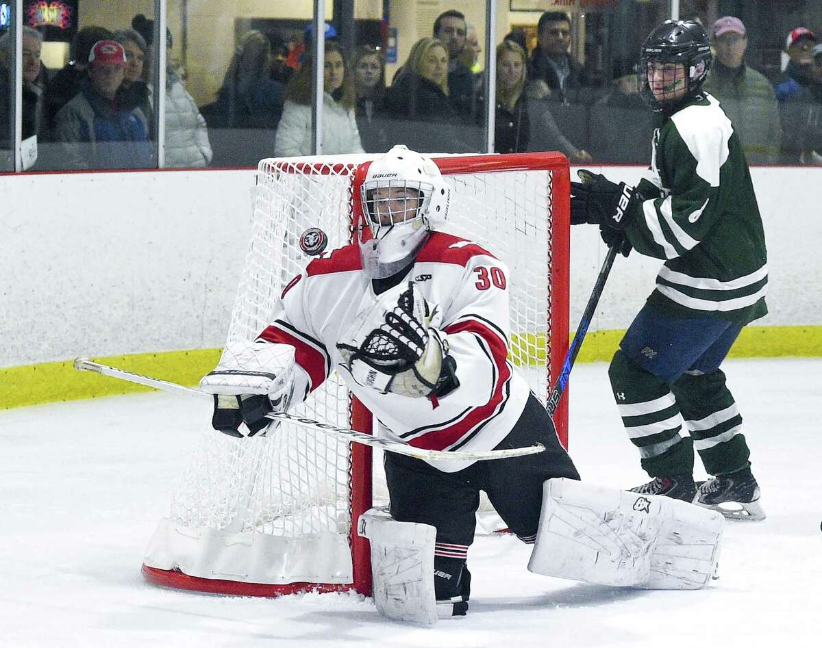 New Canaan goalie Dylan Shane (30) makes a save against Northwest Catholic in the third period of a boys hockey game at the Darien Ice House in Darien, Conn. on Saturday, Jan. 13, 2018. New Canaan defeated Northwest Catholic 3-1.