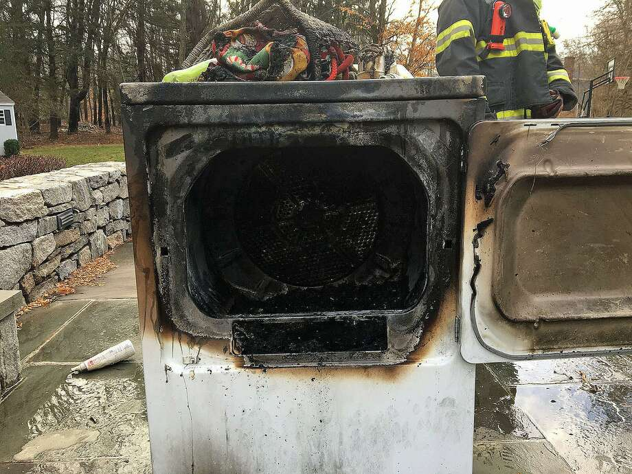 A fire on Lampwick Lane in Fairfield, Conn., on Jan. 13, 2018, did roughly $10,000 in damages, according to fire officials. But, officials said that firefighters' quick extinguishment and the homeowner's quick thinking prevents a $650,000 property loss. Photo: Contributed Photo / Fairfield Fire Department / Contributed Photo / Connecticut Post Contributed
