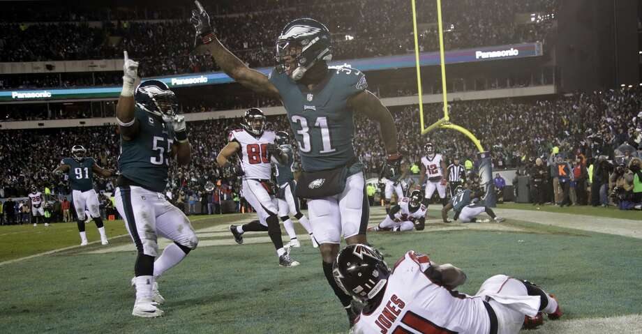 Philadelphia Eagles' Jalen Mills (31) and Brandon Graham (55) celebrate after Atlanta Falcons' Julio Jones (11) cannot catch a fourth down pass during the second half of an NFL divisional playoff football game, Saturday, Jan. 13, 2018, in Philadelphia. Philadelphia won 15-10. (AP Photo/Matt Rourke) Photo: Matt Rourke/Associated Press