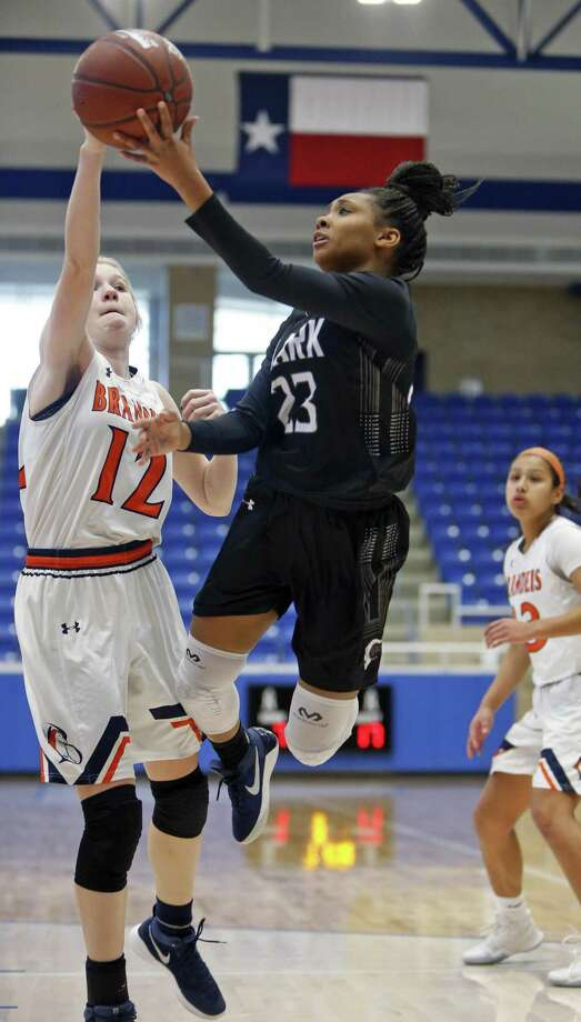 Clark's Ta'niya Jackson has her shot blocked by Brandeis' Claire Hale from the District 28-6A high school girls basketball game between Clark and Brandeis on Saturday, January 13, 2018 at Northside Complex Photo: Ron Cortes /