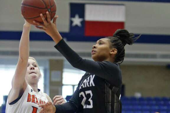 Clark's Ta'niya Jackson has her shot blocked by Brandeis' Claire Hale from the District 28-6A high school girls basketball game between Clark and Brandeis on Saturday, January 13, 2018 at Northside Complex