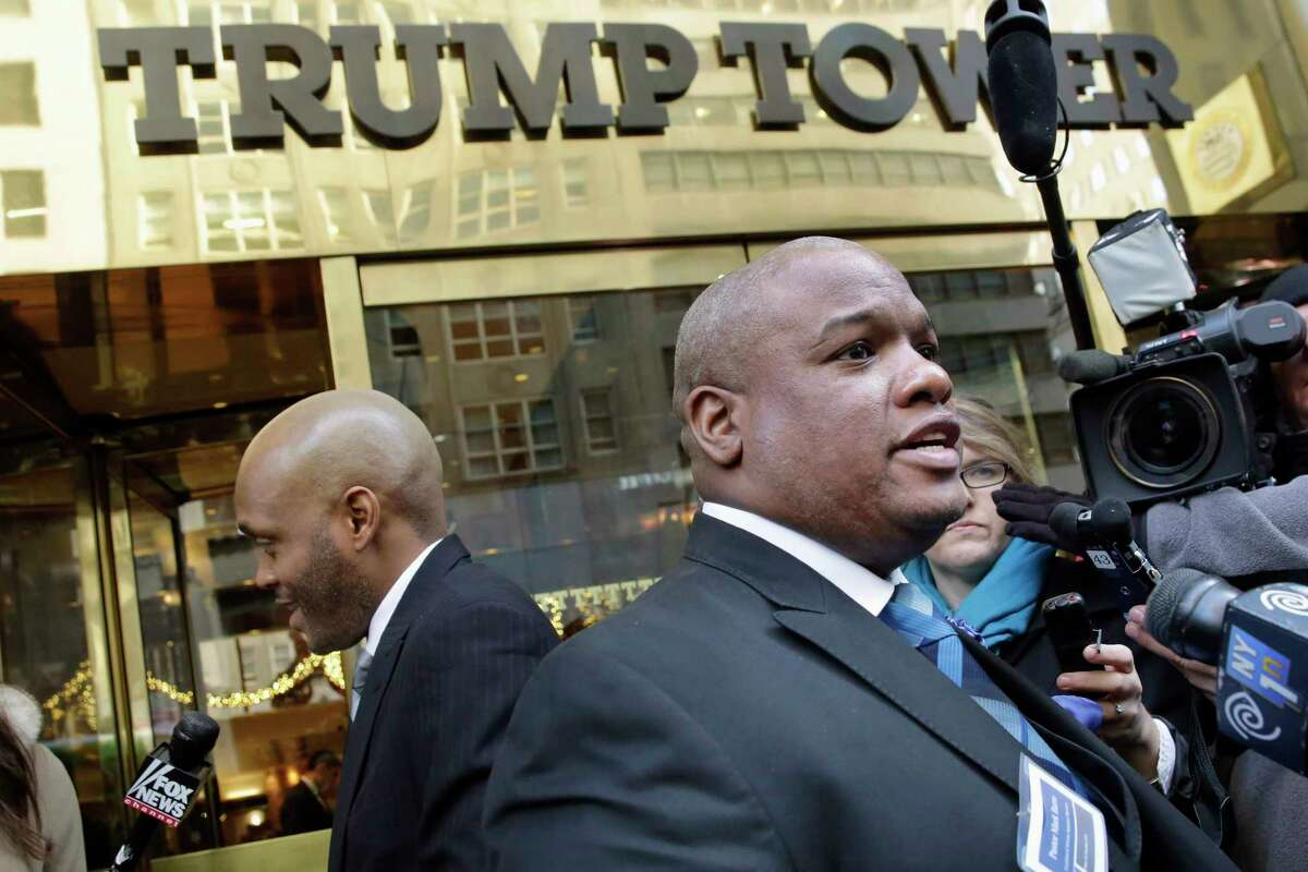 """FILE - In this Nov. 30, 2015, file photo, Pastor Mark Burns, co-founder & CEO of Christian Television Network, from Easley, S.C., right, speaks to the members of the media outside Trump Tower in New York. A few of President Donald TrumpÂ?'s leading evangelical supporters defended him after he questioned why the U.S. should accept more immigrants from Haiti and """"shithole countriesÂ?"""" in Africa. However, many other evangelicals condemned his remarks, citing their increasing devotion to fellow Christians overseas, along with the large numbers of immigrants in U.S. churches and their families. (AP Photo/Richard Drew, File)"""