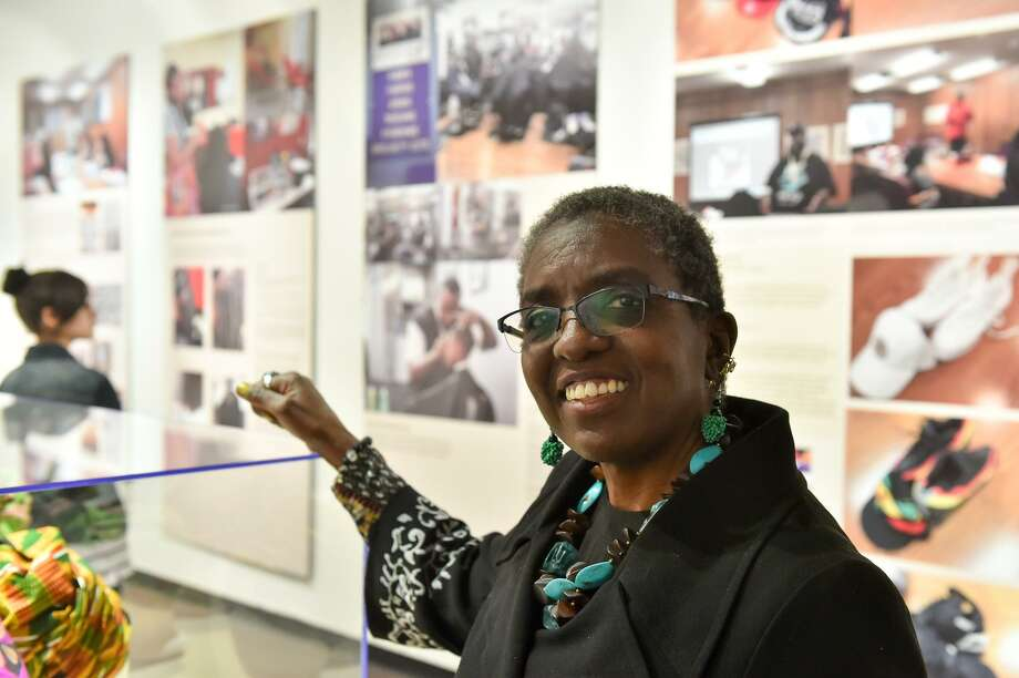 """Diana Baird N'Dlaye, a cultural heritage specialist with the Smithsonian lled the Institute of Texan Cultures new student-driven exhibit, """"The Will to Adorn,"""" one of only five across the country exploring African American dress and how it reflects on identity. The local students visited barber shops, salons, braiding studios and more to chronicle style in the San Antonio black community and create an exhibit now on display at the Institute of Texan Cultures. Photo: Robin Jerstad, Freelance / San Antonio Express News / ROBERT JERSTAD"""
