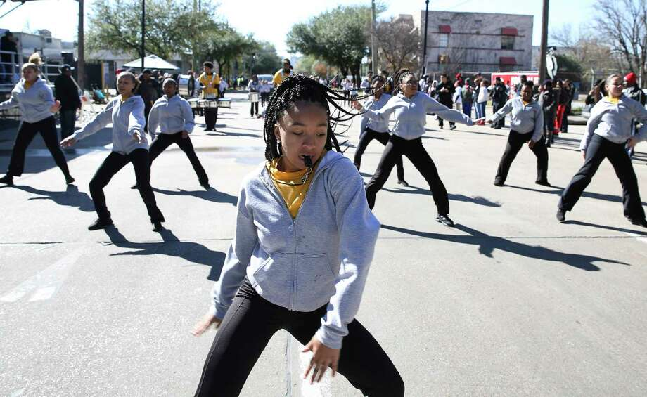Kineisha Star, 16, leads the dancers in the Isiserettes Drill and Drum Corps. from Des Moines, Iowa, marching in the 12th Annual MLK Youth Parade on Saturday in Houston. The parade featured 10 parade floats and 20 marching band.  Photo: Yi-Chin Lee, Houston Chronicle / © 2018  Houston Chronicle
