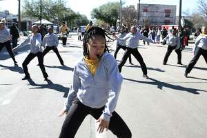Kineisha Star, 16, leads the dancers in the Isiserettes Drill and Drum Corps. from Des Moines, Iowa, marching in the 12th Annual MLK Youth Parade on Saturday in Houston. The parade featured 10 parade floats and 20 marching band.