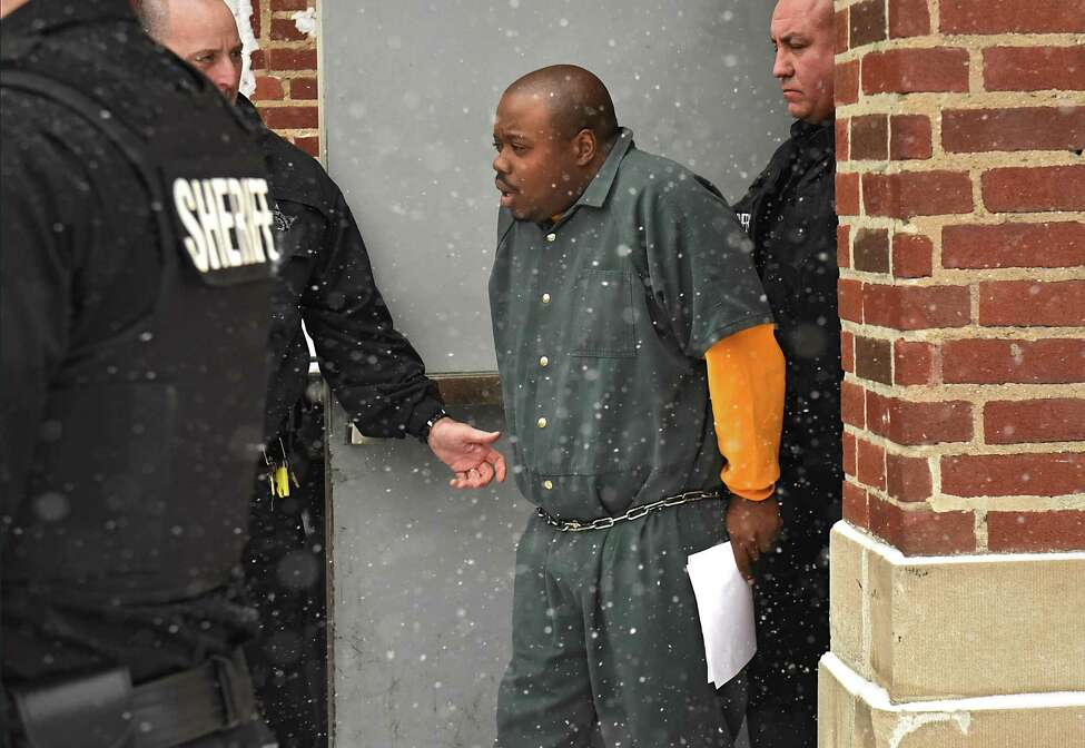 James White leaves the Troy Police Station after appearing in city court on Thursday, Jan. 4, 2018 in Troy, N.Y. White is accused of slaying four people in a Lansingburgh apartment. (Lori Van Buren / Times Union)