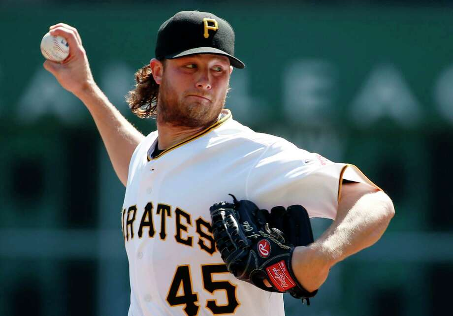 FILE - In this Sept 15, 2015, file photo, Pittsburgh Pirates starting pitcher Gerrit Cole warms up before a baseball against the Chicago Cubs in Pittsburgh. Pirates general manager Neal Huntington acknowledged a mistake was made in computing the young ace's salary and increased it to $541,000 for this year. But when Cole asked for more, he told the Pittsburgh Tribune-Review, the Pirates threatened to reduce his salary to the major league minimum, which states players with less than three years of service time must accept any salary at or over the minimum of $507,500.  (AP Photo/Gene J. Puskar, File) Photo: Gene J. Puskar, STF / AP