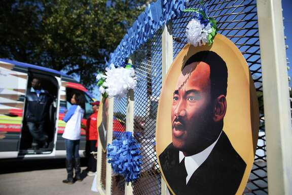 ACA Dance Company put two pictures of Dr. Martin Luther King Jr. on their trailer for the 12th Annual MLK Youth Parade on Saturday, Jan. 13, 2018, in Houston. The parade featured10 parade floats and 20 marching band.