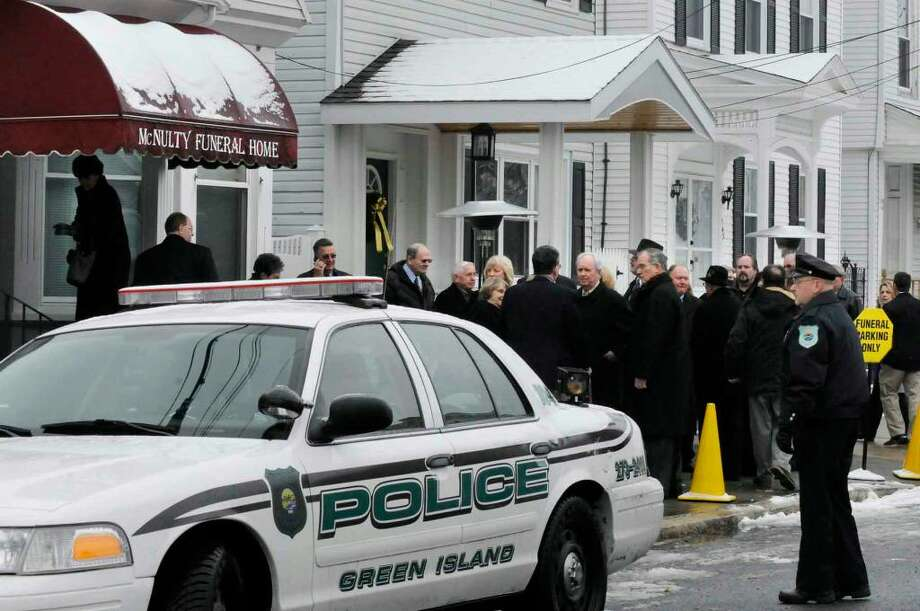 "People wait outside the McNulty Funeral Home to pay respects to John J. ""Jack"" McNulty Jr., former Green Island mayor, town supervisor and Albany County Sheriff in Green Island. (Michael P. Farrell/Albany Times Union) Photo: MICHAEL P. FARRELL"