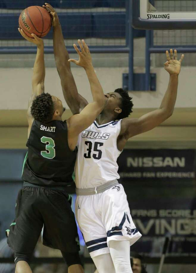 Rice forward Tim Harrison, right, blocks a shot by North Texas' Roosevelt Smart in the first half, one of the few times the Owls were able to stop Smart. Photo: Elizabeth Conley, Chronicle / © 2018 Houston Chronicle