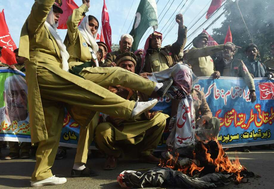 Pakistani demonstrators burn an effigy of US President Donald Trump during an anti-US protest in Lahore on January 10, 2018. Washington's freeze on billions in military assistance to Pakistan will have limited impact, thanks to its friendship with China and diminishing importance of aid to the economy, observers say -- but there could be trouble if the US calls in its debts. Exasperated by what it considers Islamabad's neglect in cracking down on militancy, Donald Trump's administration last week announced a suspension of the aid, which also also goes towards Afghanistan coalition funding. / AFP PHOTO / ARIF ALIARIF ALI/AFP/Getty Images Photo: ARIF ALI / AFP or licensors
