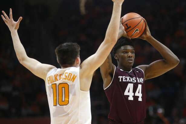 Texas A&M forward Robert Williams (44) is defended by Tennessee forward John Fulkerson (10) in the second half of an NCAA college basketball game Saturday, Jan. 13, 2018, in Knoxville, Tenn. (AP Photo/Crystal LoGiudice)