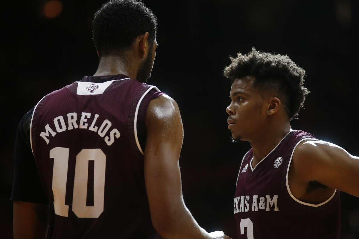 Texas A&M guard Admon Gilder, right, and Texas A&M center Tonny Trocha-Morelos (10) talk during a timeout in the second half of an NCAA college basketball game against Tennessee on Saturday, Jan. 13, 2018, in Knoxville, Tenn. (AP Photo/Crystal LoGiudice)