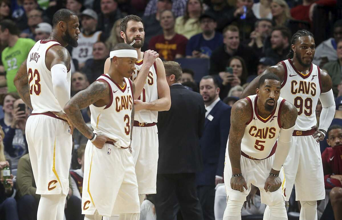 Cleveland Cavaliers players, from left to right, LeBron James, Isaiah Thomas, Kevin Love, JR Smith and Jae Crowder take a break during a review in the second half of an NBA basketball game against the Minnesota Timberwolves, Monday, Jan. 8, 2018, in Minneapolis. (AP Photo/Jim Mone)
